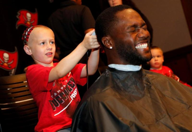Michael Johnson Gets His Head Shaved for Cut for the Cure!