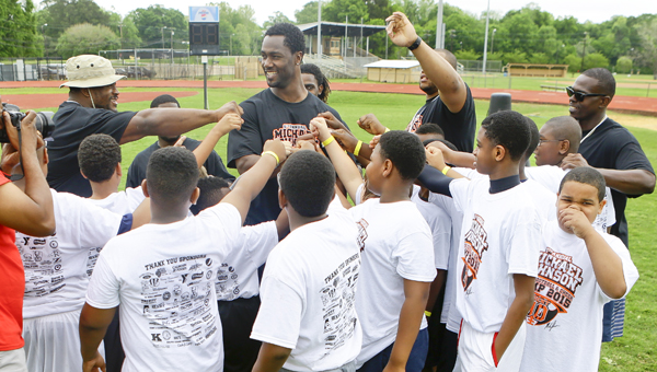LEARNING FROM A PRO: Johnson comes home for camp